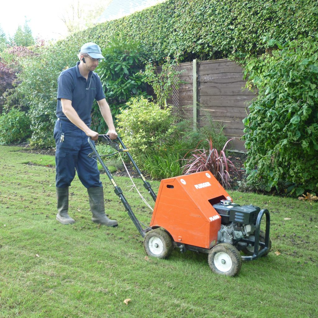Kris Lord aerating a lawn