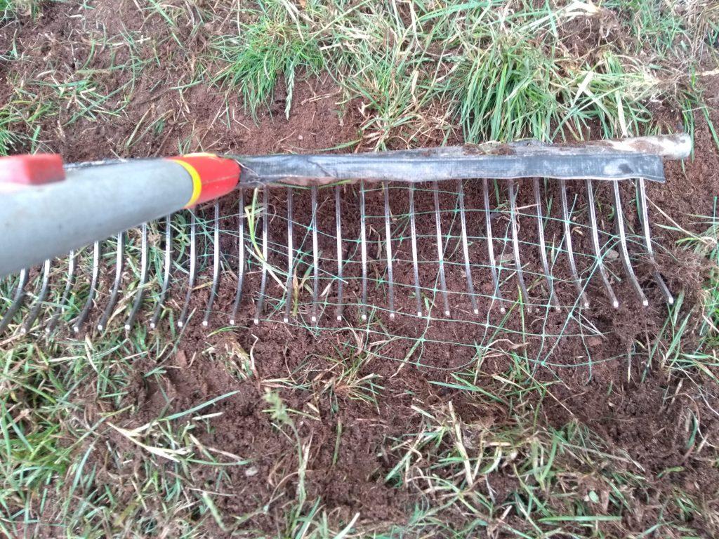 Raking netted turf