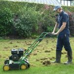 The Lawn Man scarifying a lawn