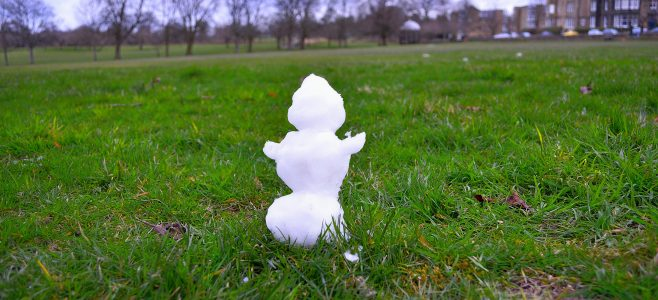 A snowman on a winter lawn